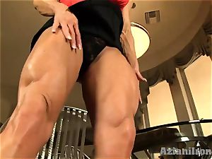 Buff chick slips dark-hued fake penis in her wet gash