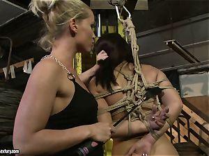 Kathia Nobili spanking the rump of torrid girl with cane