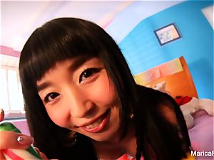 chinese star Marica Hase plays with candy spunk-pump