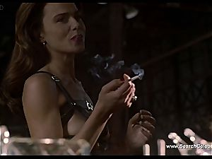 dark haired Lena Olin in lingerie displays off her diminutive boobs