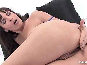 adult movie star Dana opens up her cornhole with a large plaything