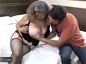 AgedLove plump mature is porking on couch