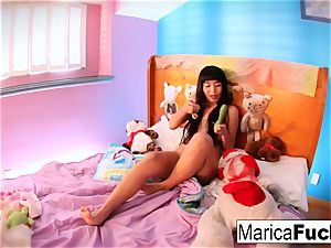Marica plays with candy wood