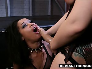 girl-on-girl dominance and strap-on act
